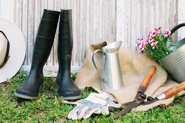Arrangement of gardening gumboots and supplies