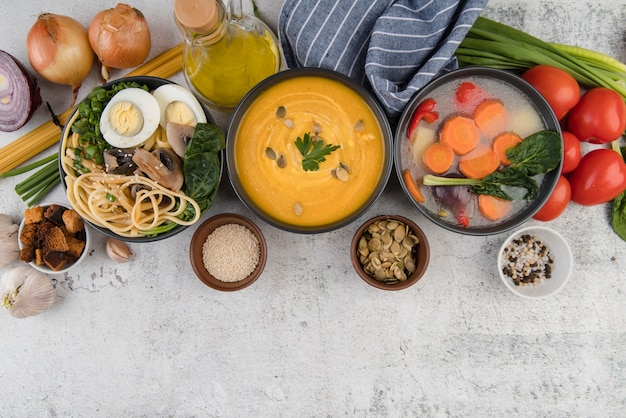 Arrangement of homemade soups and ingredients