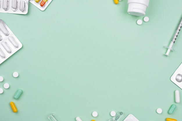 Arrangement of medical objects on green background with copy space