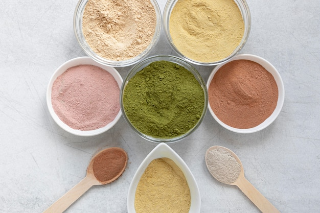 Arrangement of natural spa sand in bowls flat lay