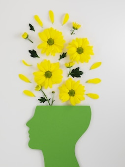 Композиция концепции оптимизма с цветами Premium Фотографии