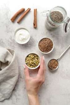 Arrangement of organic seeds and whipped cream