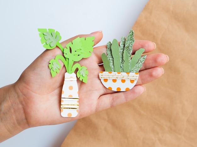 Arrangement of paper plants held in hand