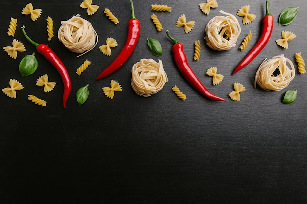 Arrangement of pasta and chili peppers