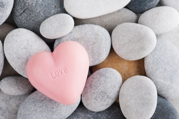 Arrangement of pebbles, pink soap