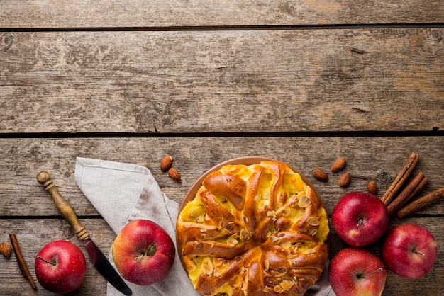 Arrangement of pie and apples with copy space background