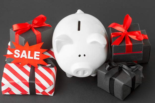 Arrangement of piggy bank and gift boxes