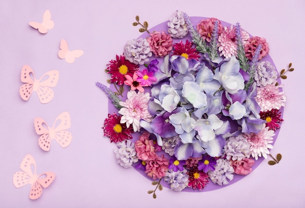 Arrangement of pretty flowers with purple background