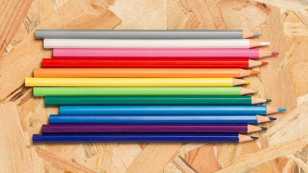 Arrangement of rainbow coloured pencils
