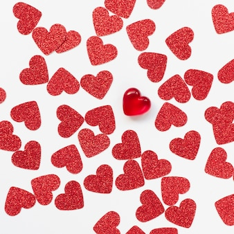Arrangement of red hearts on white background