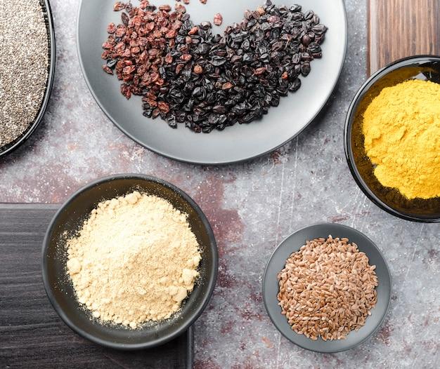 Arrangement of seeds and raisins in bowls