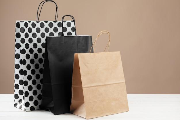 Arrangement of shopping bags on beige
