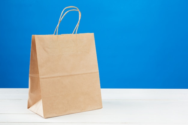 Arrangement of shopping bags on blue
