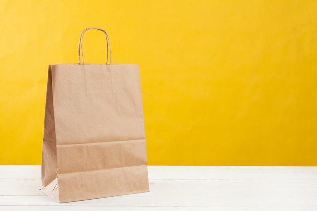 Arrangement of shopping bags on bright yellow