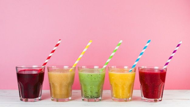 Arrangement of smoothies with pink background