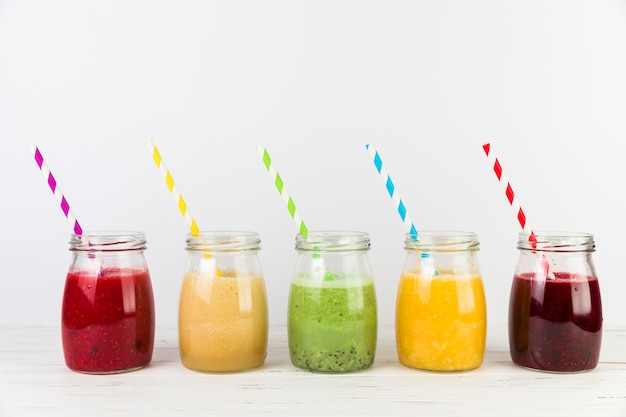 Arrangement of smoothies with straws