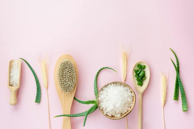 Arrangement of spoons and aloe vera leaves