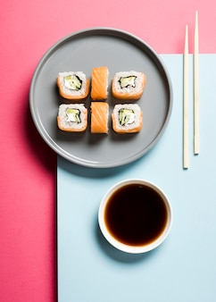 Arrangement of sushi rolls and soy sauce