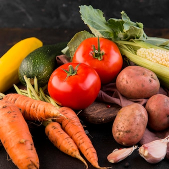 Arrangement of vegetables on dark background