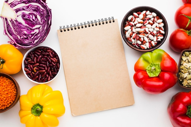 Arrangement of vegetables on empty notepad