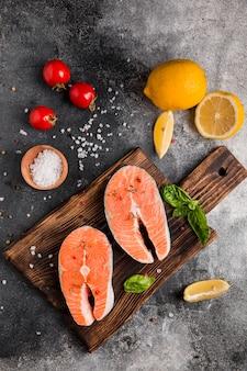 Arrangement of veggies and salmon fish top view