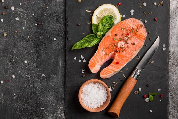 Arrangement of veggies and salmon fish with sea salt