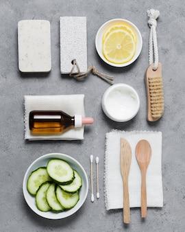 Arrangement of veggies and spa tools top view