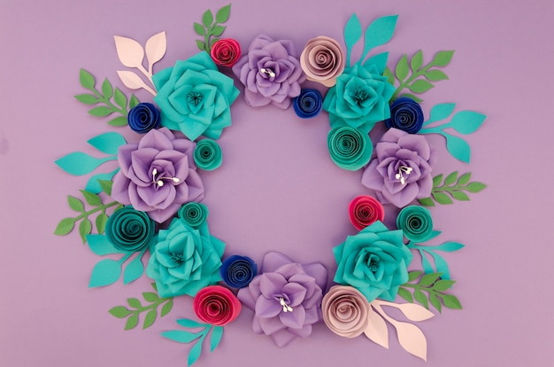 Arrangement with beautiful wreath and purple background