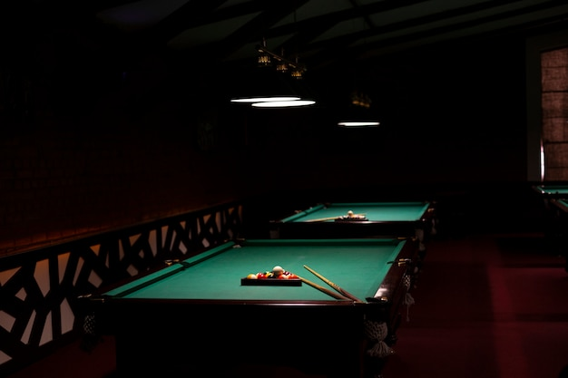 Arrangement with billiard tables and balls