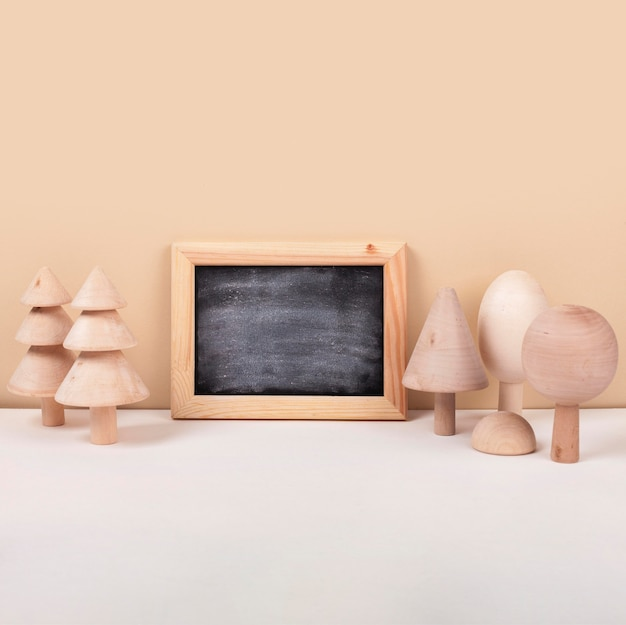 Arrangement with blackboard and trees