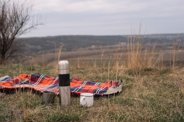 Arrangement with blanket on grass
