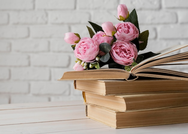Arrangement with books and beautiful flowers