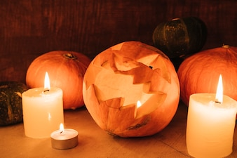 Arrangement with candles and pumpkins