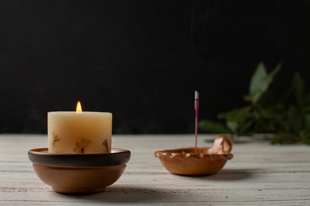 Arrangement with candles on wooden table