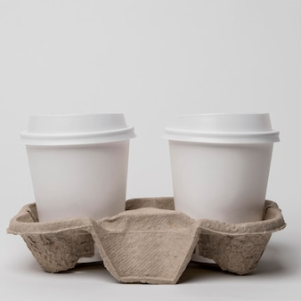 Arrangement with cardboard cup holder