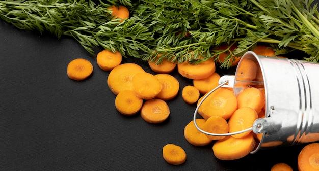 Arrangement with carrot slices in bucket