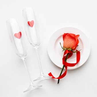 Arrangement with champagne glasses on white background
