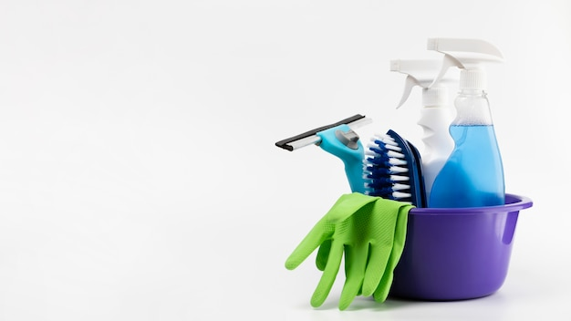 Arrangement with cleaning products in purple basin