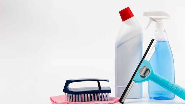 Arrangement with cleaning products and white background