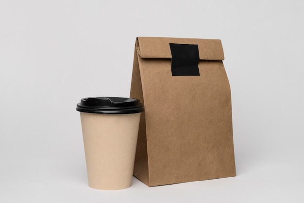 Arrangement with coffee cup and paper bag