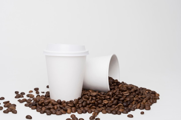 Arrangement with coffee cups and beans