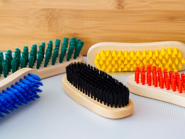 Arrangement with colourful wooden brushes