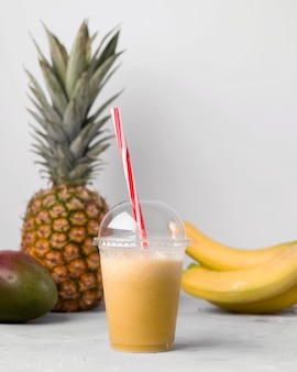 Arrangement with cup of smoothie