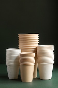 Arrangement with cups and green background