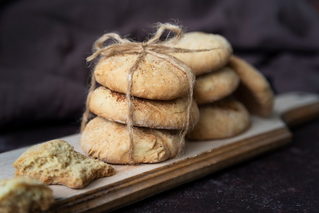Arrangement with delicious biscuits on wooden board