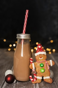 Arrangement with delicious drink and gingerbread man