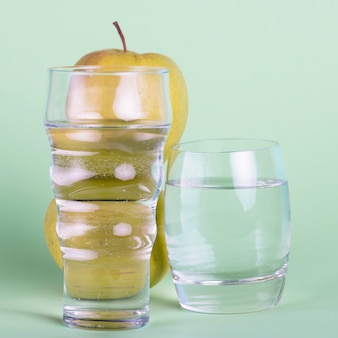 Arrangement with different sized glasses of water