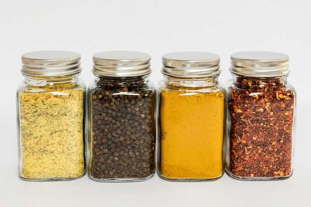 Arrangement with different spices in jars