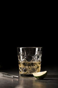 Arrangement with drink andtweezers