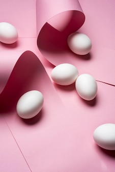 Arrangement with eggs on pink background